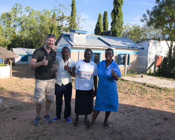 Enfo's Daniel Deimert together with IT teacher Moses Kisilu and colleagues outside their school in Lunga Lunga, Kenya.